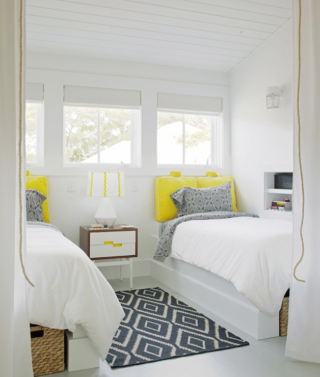 Rethink Design Studio - girl's rooms - Sherwin Williams - Extra White - West Elm Kite Kilim Rug, sloped ceiling, yellow, cushions, white, piping, headboard, built-in, twin beds, woven, baskets, blue, paisley, pillows, shared girls room, shared girls bedroom, shared kids room, shared kids bedroom, kilim rug, blue kilim rug, kite kilim rug, navy kite kilim rug,