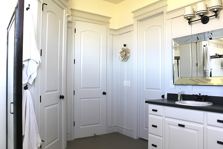 Beveled bathroom mirror transitional bathroom the for White bathroom cabinets with bronze hardware