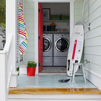 Rethink Design Studio - laundry/mud rooms - Sherwin Williams - Gladiola - outdoor, shower, red, planter, glossy, red, door, glossy, white, front load, washer, dryer, colorful, striped, towels, baskets, red door, red front door,