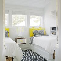 Rethink Design Studio - girl's rooms - sloped ceiling, yellow, cushions, white, piping, headboard, built-in, twin beds, woven, baskets, blue, paisley, pillows, shared girls room, shared girls bedroom, shared kids room, shared kids bedroom, kilim rug, blue kilim rug, kite kilim rug, navy kite kilim rug, West Elm Kite Kilim Rug,