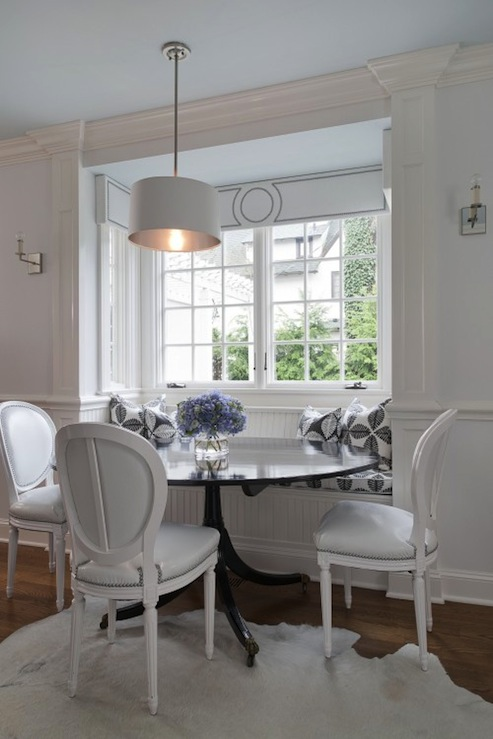 Tiffany Eastman Interiors - dining rooms - white, cornice board, nailhead trim, white, cowhide, rug, glossy, black, dining table, white, leather, oval back, Louis, chairs, built0in, beaded, banquette, window seat, white, black, pillows, white, drum, pendant, pale, blue, painted, ceiling, banquette, dining banquette, built-in banquette, built in dining banquette, kitchen banquette, beadboard dining banquette, built-in beadboard banquette, beadboard banquette, beadboard built in banquette, beadboard dining banquette,