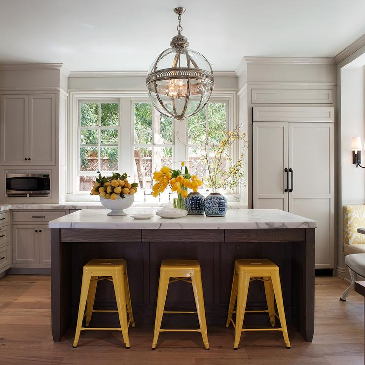 Benjamin Dhong - kitchens - Restoration Hardware Victorian Hotel Pendant, bright, yellow, tabouret, marais, stools, gray, kitchen cabinets, espresso, stained, kitchen island, marble, countertops, beveled, subway tiles, backplash, paneled, fridge,