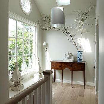 Benjamin Dhong - entrances/foyers - pale, gray, walls, console, table, tapered, gray, drum, pendant, skylight, second floor landing skylight,