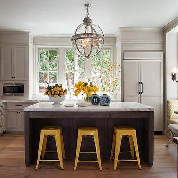 Benjamin Dhong - kitchens - Benjamin Moore - Hazy Skies - bright, yellow, tabouret, marais, stools, gray, kitchen cabinets, espresso, stained, kitchen island, marble, countertops, beveled, subway tiles, backplash, paneled, fridge, tolix stools, yellow tolix stools, light gray cabinets, light gray kitchen cabinets,