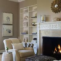 Benjamin Dhong - living rooms - white, built-ins, mocha, walls, ivory, armchairs, zebra, ottoman, white, garden stool, fireplace, small, gold, sunburst, mirror,