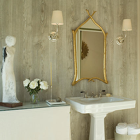 Benjamin Dhong - bathrooms - gold, branch, mirror, glossy, white, pedestal, sink, faux bois, wallpaper, linen, skirted, table, green, trim,