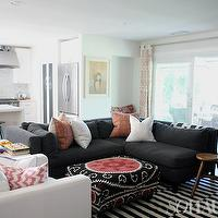 living rooms: grey couch, grey sofa, dark sofa, dark couch, stripped rug, hipster,  Amber Lewis' Living Room featured on So Haute