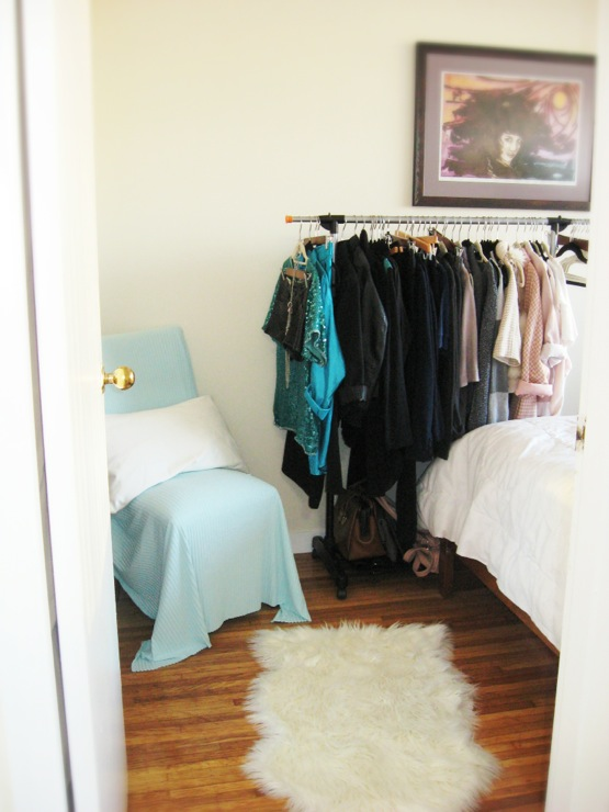 bedrooms - Ikea, clothing rack, garment rack, throw blanket, blue, white, black, turquoise, apartment, dressing room, bedroom, closet, sheep skin rug, faux sheep skin rug, dressing chair, boudoir, modern, art, wall decor, entrance, bed, hardwood floors rug, slip cover,