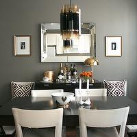Erika Brechtel - dining rooms - gray, walls, beveled, mirror, black, dining table, white, leather, open back, dining chairs, gold frames, gray rooms, gray walls, David Hicks La Fiorentina Pillow, HSN Nate Berkus Gold Ikat Bowl, Ballard Designs Macau Chair, Original Art from CalArts,