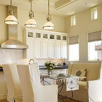 DeCesare Design Group - kitchens - white, slipcovered, wingback, settee, chairs, iron, dining table, marble, top, creamy, white, raised panel, kitchen cabinets, kitchen island, granite, countertops, glossy, white, subway tiles, backsplash, gray, linen, roman shades, wingback settee, slipcovered settee, slipcovered wingback settee, dining settee, dining wingback settee, Large Country Industrial Pendant,