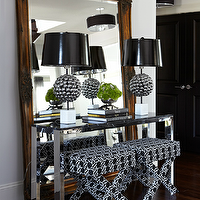 Atmosphere Interior Design - bedrooms - gilt, ornate, mirror, polished chrome, console, table, white, black, x, ottomans, metal, ball, lamps, black, vinyl, lamp shades, console table, chrome table, chrome console table, black and white stools, black and white x stools,