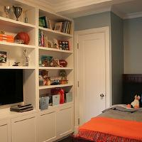 Curated - boy's rooms - blue, gray, walls, wood, bed, gray, bedding, orange, throw, white, built-ins, TV, vintage, metal, baskets, TV, kids built ins, kids built in cabinets, kids room built ins, kids room built in cabinets,