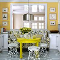House Beautiful - dining rooms - Benjamin Moore - Inner Glow - yellow, walls, yellow, gray, settee, gray, geometric, pattern, painted, floor,
