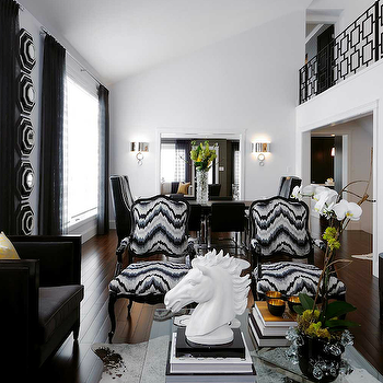 Atmosphere Interior Design - living rooms - glossy, black, French, chairs, white, brown, cowhide, rug, white, horse, statue, high-back, black, velvet, modern, chairs, sofa, round, mirrored, accent table, black chairs, velvet chairs, black velvet chairs, yellow pillows, barcelona coffee table, cowhide rug, black and white cowhide rug, kelly wearstler flair, french chairs, upholstered chairs, upholstered french chairs, french upholstered chairs, Barcelona Coffee Table, Kelly Wearstler Flair Fabric - Noir,