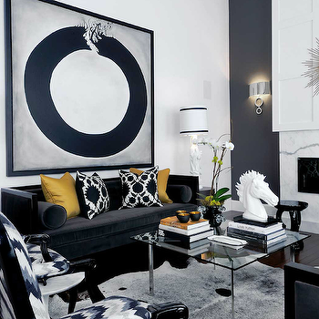 Atmosphere Interior Design - living rooms - marble, fireplace, navy blue, accent wall, cowhide, rug, high-back, black, velvet, sofa, chairs, gold, silk, pillows, glossy, black, French, chairs, gold, sunburst, mirror, black sofa, velvet sofa, black velvet sofa, high back sofa, yellow pillows, black and white pillows, barcelona coffee table, cowhide rug, black and white cowhide rug, Thomas Paul Flock Pillow, Barcelona Coffee Table, Arteriors Lola Accent Table, Kelly Wearstler Flair Fabric - Noir,