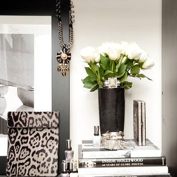 The Coveteur - closets - jewelry, black, vase, white, roses, black, frame, books, black gallery frame,  Mary Alice Stephenson - Beautiful vignette
