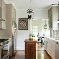 Atlanta Homes & Lifestyles - kitchens - blue, gray, walls, gray, kitchen  cabinetswhite, trim, painted, Sherwin Williams, Bright White, marble, countertops, glossy, white, subway tiles, backsplash, Sherwin Williams Pavestone,