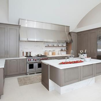 Design Galleria - kitchens - gray, kitchen cabinets, kitchen island, calcutta, marble, countertops, backsplash, chunky, gray, floating shelves, spice rack, farmhouse sink, glass-door, fridge, extra wide hood, extra wide kitchen hood,