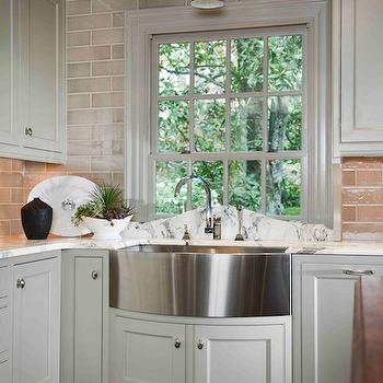 Design Galleria - kitchens - ivory, shaker, kitchen cabinets, marble, countertops, glass, subway tiles, backsplash, stainless steel, curved, front, apron, sink, curved backsplash, curved marble backsplash, curved kitchen backsplash, bow front sink, bow front kitchen sink,