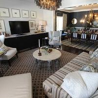 Sarah Richardson Design - living rooms - gray, pillows, beige, brown, tan, white, striped, sofa, taupe, Moorish, tiles, rug, marble, top, round, coffee table, ebony, stained, long, media, cabinet, marble, top, art, gallery, West Elm Ellery Chair, Kravet Bansuri,