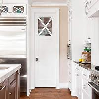 BHG - kitchens - cafe au lait, tan, walls, pocket door, pantry, white, kitchen cabinets, black, limestone, countertops, pantry door, pantry pocket door, pantry with pocket door,