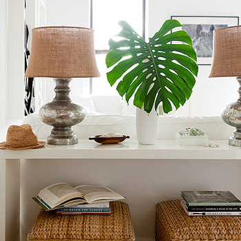 The Brooklyn Home Company - living rooms - seagrass, storage, ottomans, glossy, white, lacquer, modern, console, table, palm, leaf, pottery barn mercury glass lamp, seagrass ottomans, ottomans under table, ottomans under console table, white console table, white lacquer console table, Pottery Barn Antique Mercury Glass Lamp,
