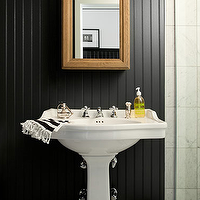 The Brooklyn Home Company - bathrooms - glossy, black, painted, beadboard, walls, white, pedestal, sink, marble, tiles, floor, white, black, striped, towels, beadboard backsplash, beadboard bathroom, bathroom beadboard, black beadboard, black beadboard backsplash,