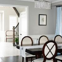 AM Dolce Vita - dining rooms - Dining Room wainscoting, Benjamin Moore Revere Pewter, Crystal Chandelier, Mahogany double pedestal dining table, cross-back dining chairs, Blue silk drapes, revere pewter,