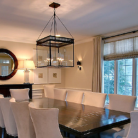 Rachel Hazelton Interior Design - dining rooms - wainscoting, sand, walls, ebony, buffet, glossy, ebony, rectangular, dining table, ivory, microfiber, dining chairs, silver, nailhead trim, sand, line, drapes, black dining table, white dining chairs, black lantern, Urban Electric Co. Michael Amato Chisolm Hall Pendant,