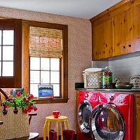 Katie Rosenfeld Design - laundry/mud rooms - glossy, red, front load, washer, dryer, striped, rug, subway tiles, backsplash, bamboo, roman shade, red, geometric, wallpaper, accent, wall,
