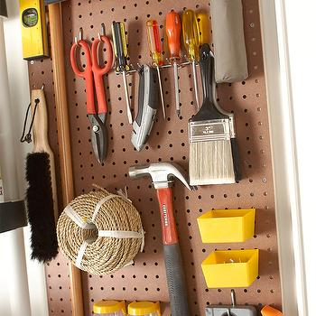 Martha Stewart - garages - utility wall, peg board, tools, organizer, peg board, utility peg board, garage peg board, well organized garage, organized garage, tools peg board,