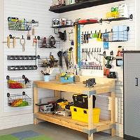 Martha Stewart - garages - green, gray, blue, carpet, tiles, wood, work station, black, plastic, tool, bins, garage shelves, garage shelving, organized garage, well organized garage, garage work station, garage work table, flor, flor carpet, flor carpet tiles,