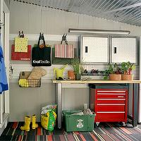 Martha Stewart - garages - carpet, tiles, industrial, table, red, tool, cart, recycling bins,  Well organized garage with carpet tiles, industrial