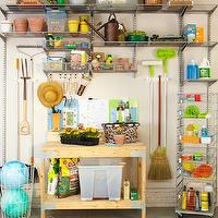 Martha Stewart - garages - blue, gray, green, carpet, tiles, wood, work station, stainless steel, rolling, cart, shelves, garage shelves, garage shelving, organized garage, well organized garage, garage work station, garage work table, flor, flor carpet, flor carpet tiles,