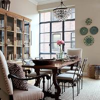 Jenny Wolf Interiors - dining rooms - tan, walls, green, blue, decorative wall plates, sisal, rug, trestle, dining table, square back, glossy, black, captain, chairs, upholstered in sand fabric, french table, french dining table, trestle dining table, Robert Abbey Bling Chandelier,