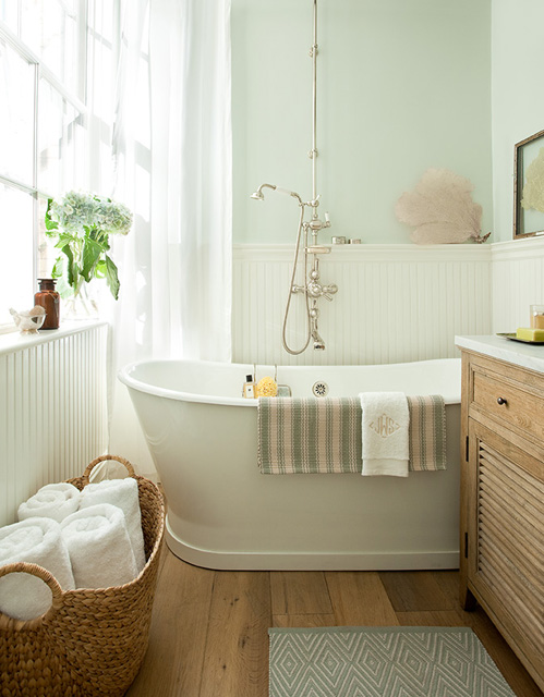 Jenny Wolf Interiors - bathrooms - blue, green, walls, chair rail, beadboard, freestanding, tub, blue, diamonds, bath mat, woven towel basket, seafan, art, oak, single, washstand, marble, countertop, sea fan, seafan, sea fan decor, seafan decor, sea fan art, seafan art,