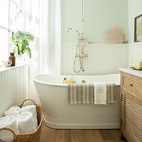 Small but gorgeous spa-like bathroom with blue green walls paint color, freestanding ...