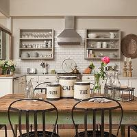 Jenny Wolf Interiors - kitchens - tan, walls, vintage, green, farmhouse, table, metal, chairs, ivory, kitchen cabinets, marble, countertops, sub way tiles, backsplash, exposed brick wall, vintage, bottles, canisters,