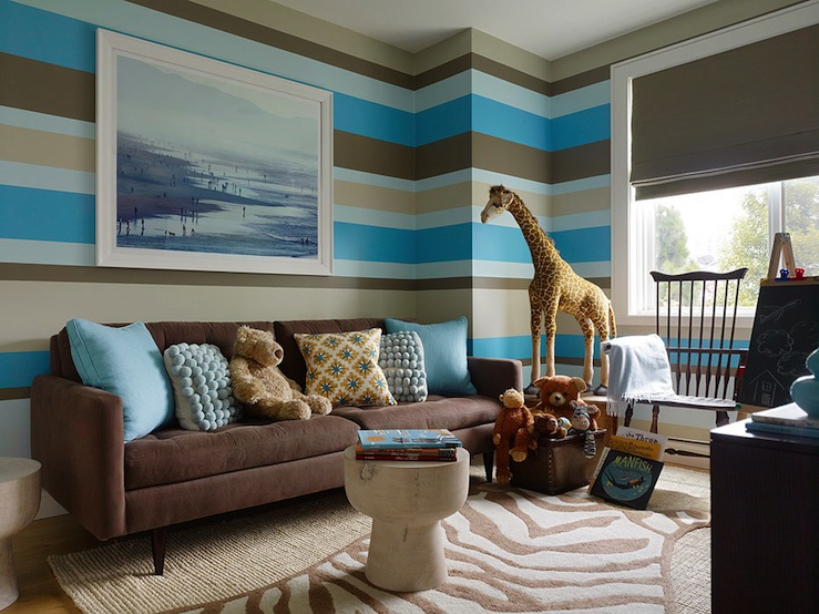 boy's rooms - Benjamin Moore - Texas Leather - Crate & Barrel Petrie Sofa Jonathan Adler Zebra Rug Roost Home Furnishings Timpani Mango Wood Stool gray roman shade brown tan blue horizontal stripes wall jute rug chalkboard easel blue pillows