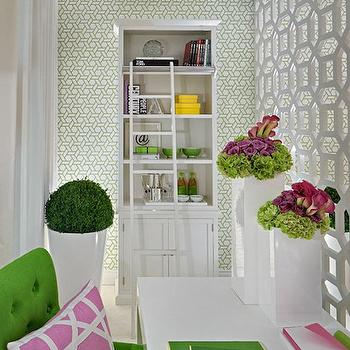 Ana Cordeiro - dens/libraries/offices - white, lattice, room divider, glossy, white, lacquer, desk, Granny Smith Apple, green, tufted, chair, pink, lattice, pillow, white, bookcase, trellis manuel canovas wallpaper, room partition, geometric room partition, room divider, white room divider, geometric room divider, Manuel Canovas Trellis Wallpaper,