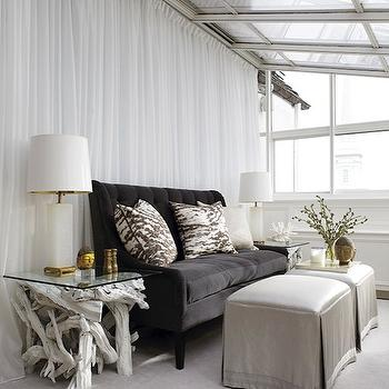 New England Home - living rooms - sunroom, silk, gray, skirted, cube, ottomans, gray, rug, black, velvet, tufted, sofa, white, charcoal, gray, pillows, white, sheers, alabaster, lamps, white, branch, tables, velvet sofa, gray sofa, gray velvet sofa, dark gray sofa, dark gray velvet sofa, glass top end tables, glass topped end tables, driftwood end tables, gray ottomans, skirted ottomans,