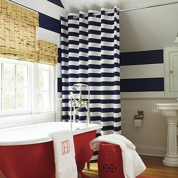 New England Home - bathrooms - chair, rail, beadboard, backsplash, white, blue, stripe, horizontal, stripe, walls, white, blue, stripe, grommet curtains, bamboo, roman shades, red, claw foot tub, red, glossy, garden stool, white, pedestal, sink, white, red, basketweave, rug, horizontal striped shower curtains, striped shower curtain, white and blue shower curtain, white and blue striped shower curtain, white and navy shower curtain, white and navy striped shower curtain, white and navy blue shower curtain, white and navy blue striped shower curtain,