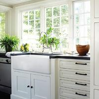 New England Home - kitchens - farmhouse, sink, white, kitchen cabinets, black, honed, countertop, polished nickel bridge, faucet, beadboard, ceiling, kitchen with no top cabinets, kitchen with no upper cabinets, oil rubbed bronze pulls, kitchen cabinets with oil rubbed bronze hardware, kitchen cabinets with oil rubbed bronze pulls,
