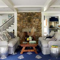 New England Home - living rooms - coffered ceiling, natural linen, slipcover, chairs, sofa, white, blue, paisley, pillows, white, blue, chevron, pillows, stone, fireplace, hammered drum stool, hammered side table, hammered drum table, Madeline Weinrib Blue Keri Rug, Roost Home Hammered Drum Stool,