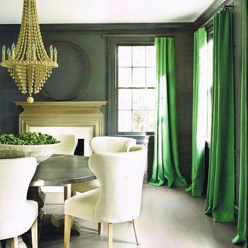 Kay Douglass - dining rooms - kelly green, silk, drapes, dark, gray, walls, fireplace, zinc, round, pedestal, table, ivory, linen, dining chairs, green drapes, green curtains, green window panels, Arteriors Maurice Chandelier,