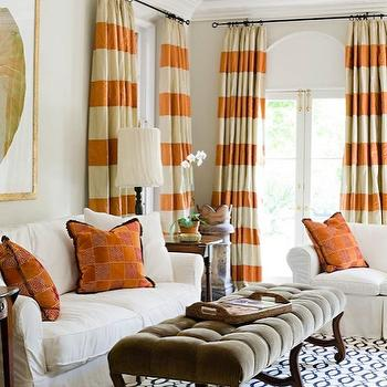 Janie Molster Designs - living rooms - mink, brown, tufted, velvet, bench, white, black, rug, tan, orange, stripe, silk, drapes, tan, walls, gold leaf, gallery, frame, orange, Greek key, pillows, white, slipcover, sofas, orange curtains, orange drapes, orange window panels, orange and white curtains, orange and white drapes, orange and white window panels, striped orange curtains, striped orange drapes, striped orange window panels,