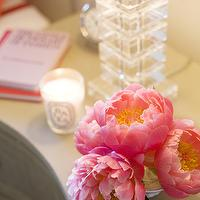 Amanda Teal Design - bedrooms - pink, peonies, glass, stacked, cube, lamp,  Beautiful pink bedside table vignette with pink peonies and square
