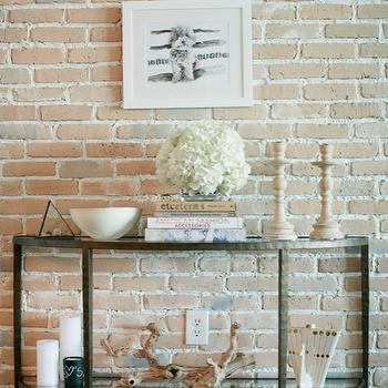 The Glitter Guide - living rooms - exposed brick wall, Demilune Console Table, Crate & Barrel Clairemont Demilune Console Table, Z Gallerie Grapewood Driftwood, West Elm Chalkboard Candle,