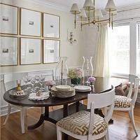 dining rooms - ivory, walls, chair rail, wainscoting, gold leaf, gallery frames, art gallery, espresso stained, vintage, dining table, white, Klismos, chairs, upholstered, gold, seat, cushion, ivory, silk, pinch-pleat, drapes, polished brass, chandelier,
