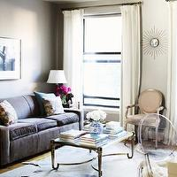The Glitter Guide - living rooms - white, drapes, white, black, Greek key, trim, , gray, walls, cowhide, rug, layered over sisal, rug, vintage, Ebay, French Louis XV, chair, upholstered, Kelly Wearstler, Lee Jofa, metallic, fabric, gold, ebay, flush mount, pendant, light, Mitchell Gold + Bob Williams Sofa, French Brass Cocktail Table - Ebay,